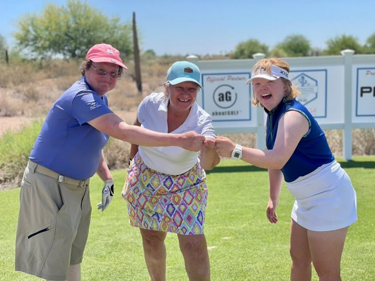 Having fun on the golf course - adaptive golfers - fist pumps